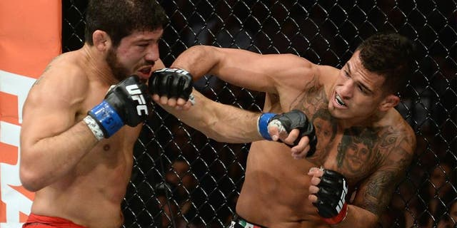 LAS VEGAS, NV - DECEMBER 06: (R-L) Anthony Pettis punches Gilbert Melendez in their UFC lightweight championship bout during the UFC 181 event inside the Mandalay Bay Events Center on December 6, 2014 in Las Vegas, Nevada. (Photo by Robert Laberge/Zuffa LLC/Zuffa LLC via Getty Images)