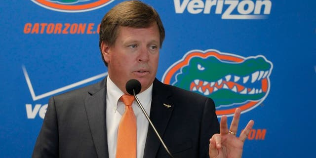 Dec 6, 2014; Gainesville, FL, USA; Florida Gators head coach Jim McElwain is introduced during a press conference at Ben Hill Griffin Stadium. Mandatory Credit: Kim Klement-USA TODAY Sports