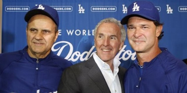 Sept. 17: Los Angeles Dodgers owner Frank McCourt, center, shakes hands with hitting coach Don Mattingly, right, after a news conference to name Mattingly the Dodgers manager for the 2011 season and that Joe Torre, left, will step aside from the position in Los Angeles.