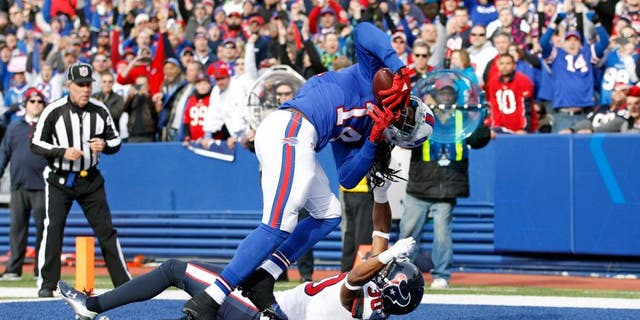 Dec 6, 2015; Orchard Park, NY, USA; Buffalo Bills wide receiver Sammy Watkins (14) makes a catch for a touchdown as Houston Texans strong safety Kevin Johnson (30) defends during the first quarter at Ralph Wilson Stadium. Mandatory Credit: Kevin Hoffman-USA TODAY Sports