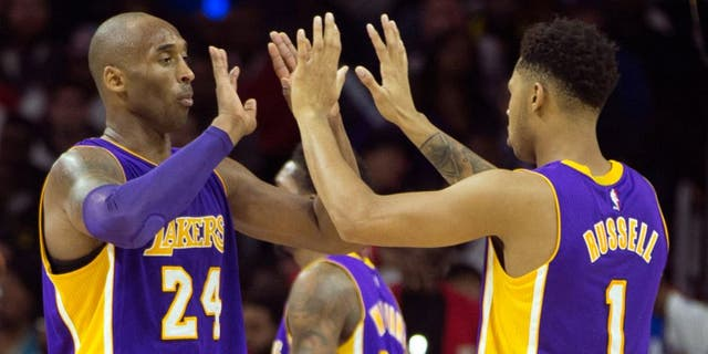 PHILADELPHIA, PA - DECEMBER 1: Kobe Bryant #24 and D'Angelo Russell #1 of the Los Angeles Lakers react in the game against the Philadelphia 76ers on December 1, 2015 at the Wells Fargo Center in Philadelphia, Pennsylvania. NOTE TO USER: User expressly acknowledges and agrees that, by downloading and or using this photograph, User is consenting to the terms and conditions of the Getty Images License Agreement. (Photo by Mitchell Leff/Getty Images)
