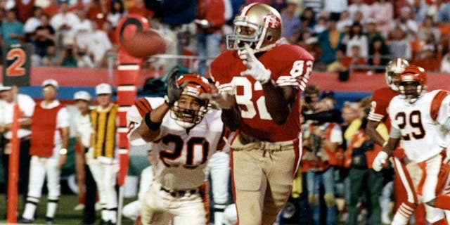 MIAMI, FL - JANUARY 22: Wide receiver John Taylor #82 of the San Francisco 49ers catches the game-winning 10-yard touchdown reception in the final moments of the 49ers 20-16 victory over the Cincinnati Bengals in Super Bowl XXIII on January 22, 1989 at Joe Robbie Stadium in Miami, Florida. (Photo by Robert Riger/Getty Images)