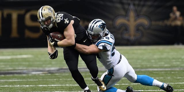 Josh Hill #89 of the New Orleans Saints is brought down by Luke Kuechly #59 of the Carolina Panthers during a game at the Mercedes-Benz Superdome on December 6, 2015 in New Orleans, Louisiana. Carolina defeated New Orleans 41-38. (Photo by Stacy Revere/Getty Images)