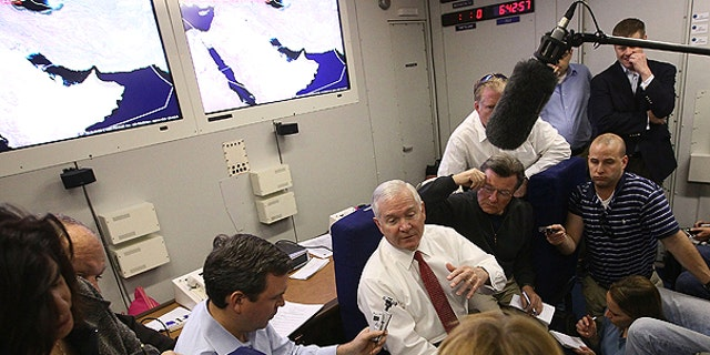 Dec. 10: U.S. Secretary of Defense Robert Gates answers questions from reporters on board his plane returning to the United States shortly after departing from Abu Dhabi.
