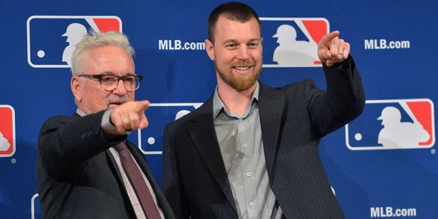 Ben Zobrist, right, with Chicago Cubs manager Joe Maddon in December.