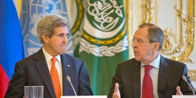 U.S. Secretary of State John Kerry, left, listens to Russia's Foreign Minister Sergey Lavrov before the start of their joint meeting with U.N.-Arab League envoy for Syria Lakhdar Brahimi at the U.S. ambassador's residence in Paris, France, Monday, Jan. 13, 2014. Kerry is in Paris for meetings on Syria to rally international support for ending the three-year civil war in Syria. (AP Photo/Pablo Martinez Monsivais, Pool)