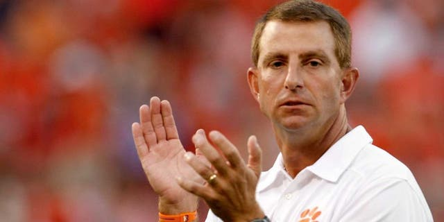 CLEMSON, SC - AUGUST 31: Dabo Swinney Head Coach of the Clemson Tigers directs warmups prior to the game against the Georgia Bulldogs at Memorial Stadium on August 31, 2013 in Clemson, South Carolina. (Photo by Tyler Smith/Getty Images)