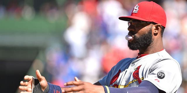 Sep 19, 2015; Chicago, IL, USA; St. Louis Cardinals right fielder Jason Heyward (22) stretches before the game between the Chicago Cubs and the St. Louis Cardinals at Wrigley Field. Mandatory Credit: Jasen Vinlove-USA TODAY Sports