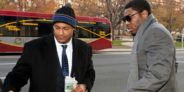 FILE - In this Nov. 30, 2012, file photo, New Orleans Saints football defensive end Will Smith, left, and linebacker Jonathan Vilma arrive at an attorney's office in Washington, for a hearing on their appeals of bounties suspensions.