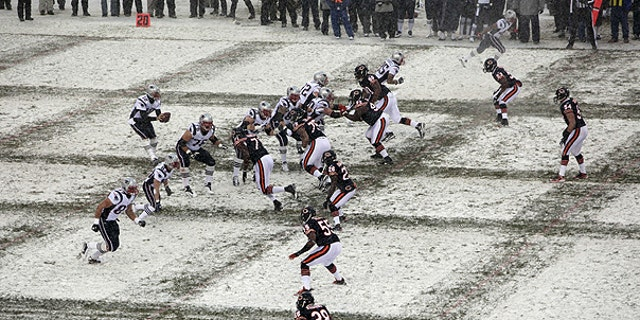 Dec. 12: New England Patriots quarterback Tom Brady (12) takes a snap from center in the first half an NFL football game against the Chicago Bears in Chicago.