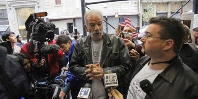 Nov. 16: Pastor Terry Jones, center, of the Dove World Outreach Center of Gainesville, Fla., speaks to reporters across the street from the proposed Islamic cultural center near the World Trade Center site in New York.
