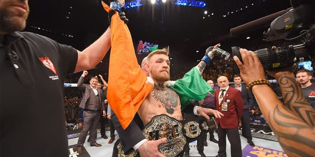 LAS VEGAS, NV - DECEMBER 12: Conor McGregor of Ireland reacts to his victory over Jose Aldo of Brazil in their UFC featherweight championship bout during the UFC 194 event inside MGM Grand Garden Arena on December 12, 2015 in Las Vegas, Nevada. (Photo by Josh Hedges/Zuffa LLC/Zuffa LLC via Getty Images)