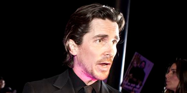 """December 12, 2011: English actor Christian Bale speaks to journalists during an interview on the red carpet as he arrives for an event of the Zhang Yimou-directed new movie """"The Flowers of War"""" in Beijing, China."""