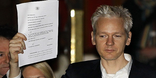 Dec. 16: WikiLeaks founder Julian Assange holds up a court document after he was released on bail in London.