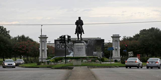 In this Sept. 2, 2015 photo, a statue of P.G.T. Beauregard is seen at the entrance to City Park at Esplanade Ave. in New Orleans.