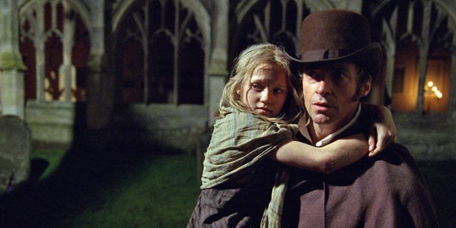 """A Utah family's Easter Sunday performance of the """"Les Miserables"""" tune """"One Day More"""" was posted on Monday to Facebook -- where it's become a viral hit. Actors Hugh Jackman and Isabelle Allen are seen in the 2012 film adaptation of the musical."""