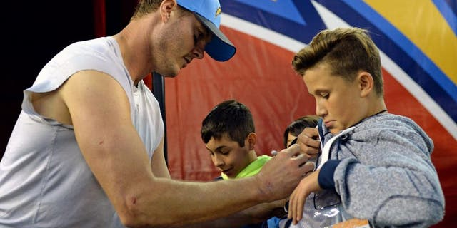 Dec 20, 2015; San Diego, CA, USA; San Diego Chargers quarterback Philip Rivers (17) signs autographs for fans after the Chargers beat the Miami Dolphins 30-14 at Qualcomm Stadium. Mandatory Credit: Jake Roth-USA TODAY Sports