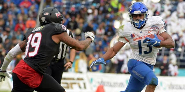Dec 23, 2015; San Diego, CA, USA; Boise State Broncos running back Jeremy McNichols (13) is pursued by Northern Illinois Huskies cornerback Shawun Lurry (19) in the 2015 Poinsettia Bowl at Qualcomm Stadium. Mandatory Credit: Kirby Lee-USA TODAY Sports