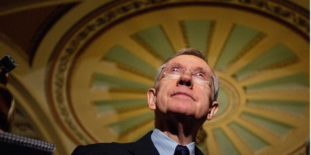 Dec. 24: Senate Majority Leader Harry Reid listens to questions following the passage of the Senate health care bill.