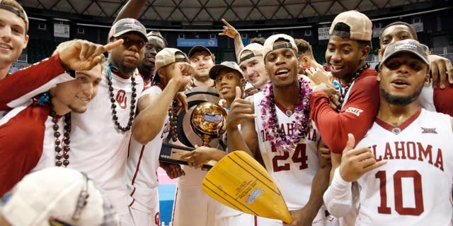 Dec 25, 2015; Honolulu, HI, USA; The Oklahoma Sooners celebrate after defeating the Harvard Crimson at the Stan Sheriff Center. Oklahoma Sooners defeated the Harvard Crimson 83-71. Mandatory Credit: Marco Garcia-USA TODAY Sports