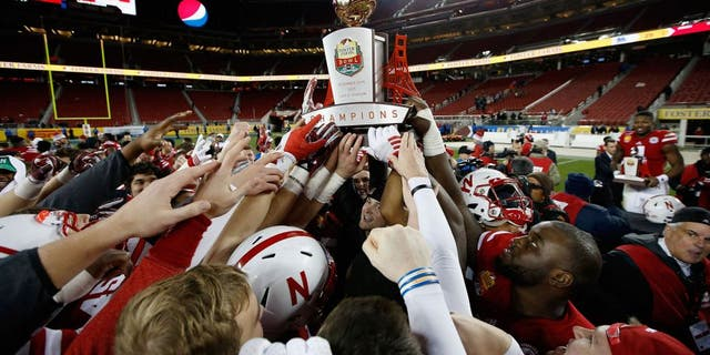 SANTA CLARA, CA - DECEMBER 26: The Nebraska Cornhuskers celebrate with the trophy after they beat the UCLA Bruins in the Foster Farms Bowl at Levi's Stadium on December 26, 2015 in Santa Clara, California. (Photo by Ezra Shaw/Getty Images)