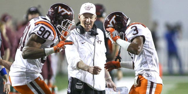 Dec 26, 2015; Shreveport, LA, USA; Virginia Tech Hokies head coach Frank Beamer celebrates with defensive end Dadi Lhomme Nicolas (90) and cornerback Greg Stroman (3) after Stroman returns a punt for a touchdown during the second quarter against the Tulsa Golden Hurricane at Independence Stadium. Mandatory Credit: Troy Taormina-USA TODAY Sports