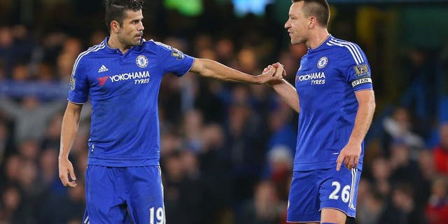 LONDON, ENGLAND - DECEMBER 26: John Terry of Chelsea congratulates Diego Costa of Chelsea after he scores to make it 2-2 during the Barclays Premier League match between Chelsea and Watford at Stamford Bridge on December 26, 2015 in London, England. (Photo by Catherine Ivill - AMA/Getty Images)