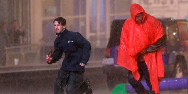 Dec. 26, 2015: People run as weather sirens sound as a severe storm passes over downtown Dallas.