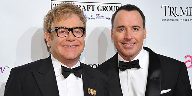 In this Oct. 18, 2010 file photo, Sir Elton John, left, and husband David Furnish attend the Ninth Annual Elton John AIDS Foundation benefit 'An Enduring Vision' at Cipriani Wall Street in New York.