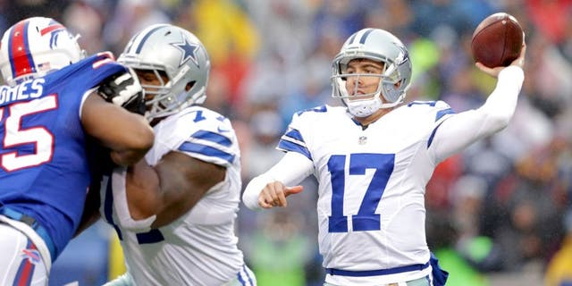 ORCHARD PARK, NY - DECEMBER 27: Kellen Moore #17 of the Dallas Cowboys throws against the Buffalo Bills during the first half at Ralph Wilson Stadium on December 27, 2015 in Orchard Park, New York. (Photo by Brett Carlsen/Getty Images)