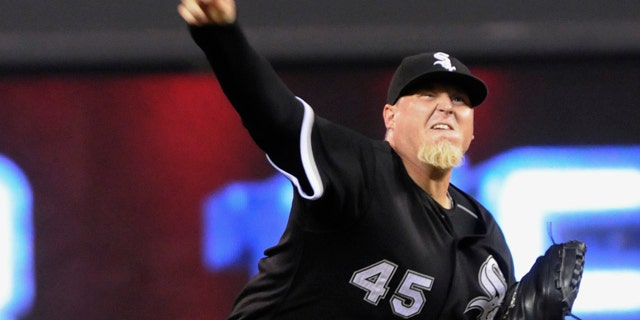 FILE - In this July 15, 2010, file photo, Chicago White Sox pitcher Bobby Jenks throws against the Minnesota Twins during a baseball game in Minneapolis.