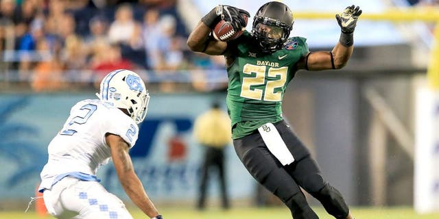 ORLANDO, FL - DECEMBER 29: Terence Williams #22 of the Baylor Bears is defended by Des Lawrence #2 of the North Carolina Tar Heels of the Russell Athletic Bowl game at Orlando Citrus Bowl on December 29, 2015 in Orlando, Florida. (Photo by Rob Foldy/Getty Images)
