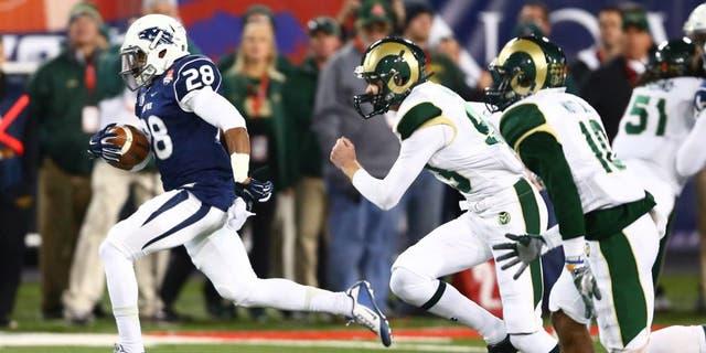 Dec 29, 2015; Tucson, AZ, USA; Nevada Wolf Pack kick returner Elijah Mitchell (28) returns a kickoff for a touchdown against the Colorado State Rams in the second quarter of the Arizona Bowl at Arizona Stadium. Mandatory Credit: Mark J. Rebilas-USA TODAY Sports