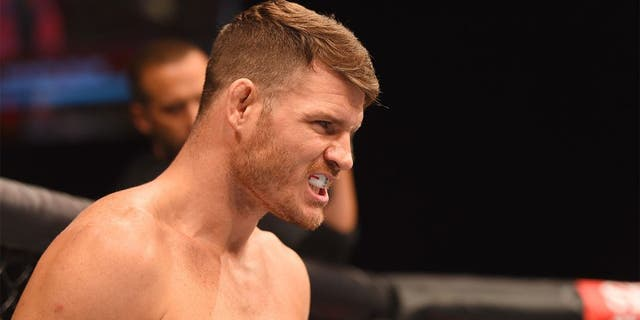 GLASGOW, SCOTLAND - JULY 18: Michael Bisping of England stands in the Octagon before his middleweight fight against Thales Leites of Brazil during the UFC Fight Night event inside the SSE Hydro on July 18, 2015 in Glasgow, Scotland. (Photo by Josh Hedges/Zuffa LLC/Zuffa LLC via Getty Images)