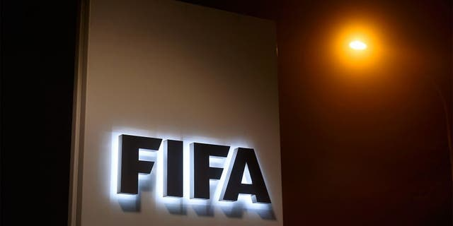 """A sign of the FIFA is seen at the entrance of its headquarters on December 3, 2015 in Zurich. The multi-million dollar corruption scandal engulfing FIFA widened on December 3, with 16 people indicted by US justice officials who pledged an unremitting crackdown on an """"outrageous"""" betrayal of trust. / AFP / FABRICE COFFRINI (Photo credit should read FABRICE COFFRINI/AFP/Getty Images)"""