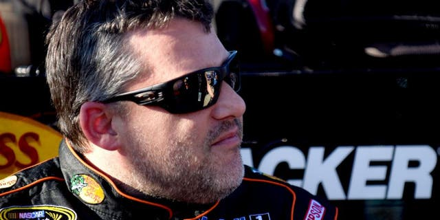 RICHMOND, VA - SEPTEMBER 11: Tony Stewart, driver of the #14 Bass Pro Shops/Mobil 1 Chevrolet, looks on during qualifying for the NASCAR Sprint Cup Series Federated Auto Parts 400 at Richmond International Raceway on September 11, 2015 in Richmond, Virginia. (Photo by Jonathan Moore/NASCAR via Getty Images)