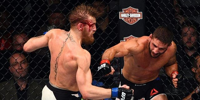LAS VEGAS, NV - JULY 11: (L-R) Conor McGregor punches Chad Mendes during the UFC 189 event inside MGM Grand Garden Arena on July 11, 2015 in Las Vegas, Nevada. (Photo by Jeff Bottari/Zuffa LLC/Zuffa LLC via Getty Images)