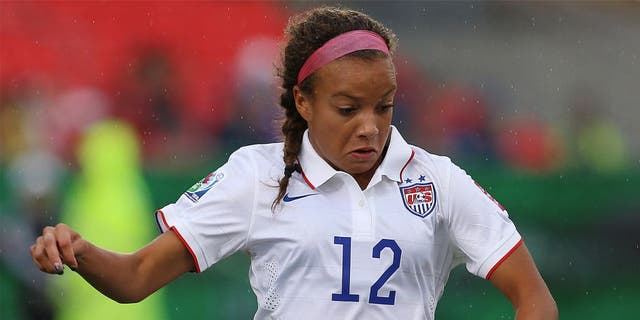 TORONTO, ON - AUGUST 16: Mallory Pugh of the United States in action during the FIFA U-20 Women's World Cup Canada 2014 Quarter Final match between Korea DPR and the United States at the National Soccer Stadium on August 16, 2014 in Toronto, Ontario, Canada. (Photo by Vaughn Ridley/Getty Images)