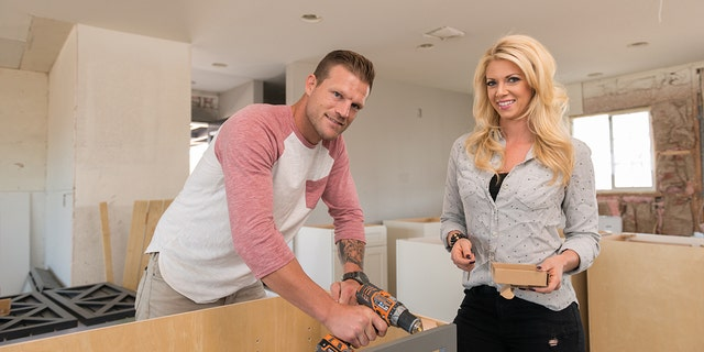 "Aubrey (R), helps Bristol (L), assemble their cabinets prior to installing them in their new kitchen, as seen on ""Flip or Flop Las Vegas."""