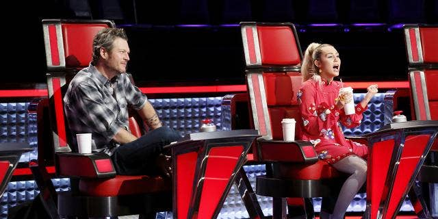 """Miley Cyrus on """"The Voice"""" with Blake Shelton."""