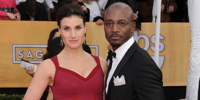 Jan. 27, 2013: Actors Idina Menzel, left, and Taye Diggs arrive at the 19th Annual Screen Actors Guild Awards at the Shrine Auditorium in Los Angeles.