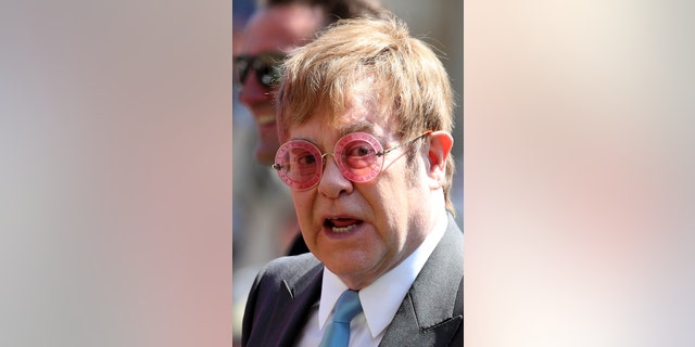 Elton John leaves St George's Chapel at Windsor Castle after the wedding of Meghan Markle and Prince Harry. Saturday May 19, 2018.