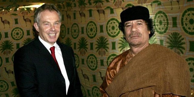 Former British Prime Minister Tony Blair and Libyan leader Muammar Qaddafi meet in 2007 (AP)