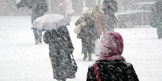People in snowstorm