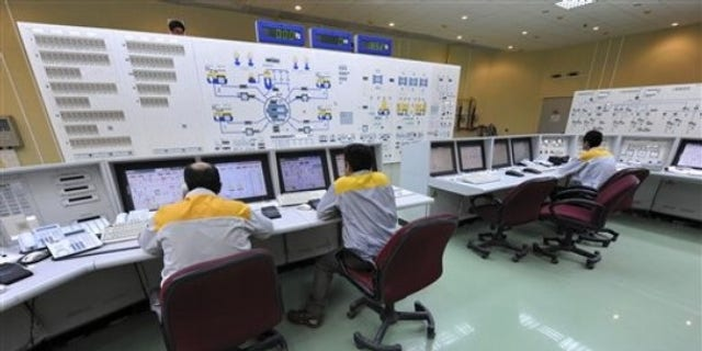 Iranian technicians work at the Bushehr nuclear power plant, outside the southern city of Bushehr, Iran.