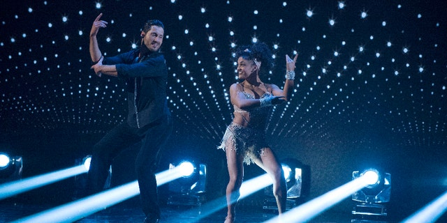 """DANCING WITH THE STARS - """"Episode 2306"""" - The nine remaining celebrities ready themselves for one of the hottest nights in the ballroom - Latin Night - with each celebrity performing either a rumba, salsa, samba, paso doblé, cha cha or Argentine tango, on """"Dancing with the Stars,"""" live, MONDAY, OCTOBER 17 (8:00-10:01 p.m. EDT), on the ABC Television Network. (ABC/Eric McCandless)VALENTIN CHMERKOVSKIY, LAURIE HERNANDEZ"""