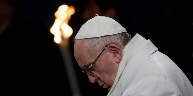 Pope Francis leads the Via Crucis (Way of the Cross) torchlight procession celebrated in front of the Colosseum on Good Friday in Rome, Friday, March 25, 2016.