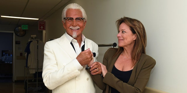 KFC and ABC shared photos of Colonel Sanders (George Hamilton) greeting cast member Nancy Lee Grahn, who looks just as surprised as anybody.