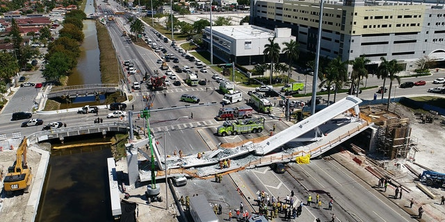 A collapsed pedestrian bridge is seen near the campus of Florida International University in Miami.