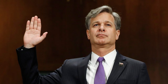 FBI Director nominee Christopher Wray is sworn-in on Capitol Hill in Washington, Wednesday, July 12, 2017, prior to testifying at his confirmation hearing before the Senate Judiciary Committee. (AP Photo/Pablo Martinez Monsivais)
